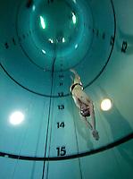 Steinar Schjagen near the bottom of dive tank.  Freediving in a tank belonging to Royal Norwegian Navy Diving School at Haakonsvern Naval base, Norway.