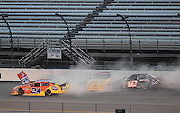 May 1, 2009; Richmond, VA, USA; NASCAR Nationwide Series drivers Eric McClure (24), Scott Lagasse Jr (11) and Justin Allgaier (12) crash during the Lipton Tea 250 at the Richmond International Raceway. Mandatory Credit: Mark J. Rebilas-