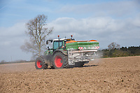 Spreading base fertilser onto ploughed field - Lincolnshire, March