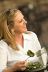 Woman eating salad and smiling