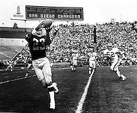 Charlie Smith gathers in a pass for the Raiders..photo Ron Riesterer