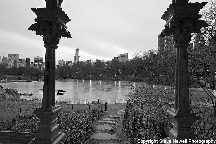 """Rambling Sunset"" Black and White Central Park New York. I shot this scene in the days before the worst storm in 20 years blew in on a Friday and lasted through Sunday.  The Governors in several states banned driving personal vehicles on the public highways for a couple days.  Being from Lake Tahoe I came prepared for the storm and was excited to capture New York City and Central Park with fresh snow.  The contrast of the abundant tall buildings surrounding Central Park was surreal. The loud noise of the city's activity was replaced with the solitude of nature inside the parks boundaries. The birds enjoyed the exposed water in the ice ponds and weren't bothered in sharing the experience with their human companions visiting the park for the day. Many families took to the park to play in the fluffy deep fresh snow with sleds for the hills and entertaining snow ball battles. I still found myself at times insulated from the park visitors and the bustling city by the absolute quietness nature offers in the isolated mountains of  my home town. Black and white photography is still my favorite so you will see many images offered in Color and BW."