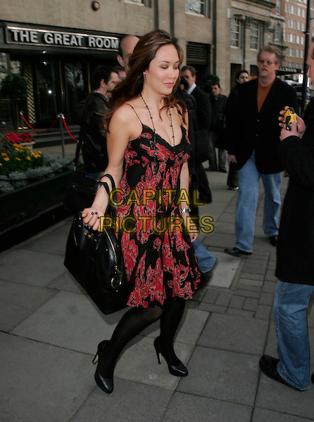 MYLEENE KLASS.Leaving the TRIC Awards (The television and Radio Industries Club) at grosvenor House, Park Lane,.London, England, March 6th 2007..full length red and black patterned print dress YSL Muse bag tights shoes funny eyes shut closed.CAP/AH.©Adam Houghton/Capital Pictures.