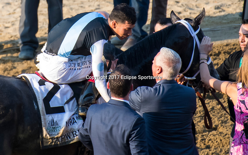 ELMONT, NY - JUNE 10: Jose Ortiz, aboard Tapwrit #2, is congratulated by trainer Todd Pletcher after winning the 149th Belmont Stakes on Belmont Stakes Day at Belmont Park on June 10, 2017 in Elmont, New York (Photo by Dan Heary/Eclipse Sportswire/Getty Images)