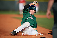 Dartmouth Big Green second baseman Sean Sullivan (4) slides safely into third base during a game against the Northeastern Huskies on March 3, 2018 at North Charlotte Regional Park in Port Charlotte, Florida.  Northeastern defeated Dartmouth 10-8.  (Mike Janes/Four Seam Images)