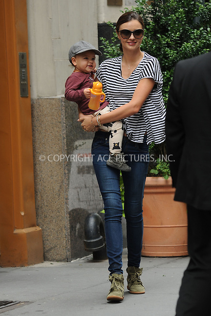 WWW.ACEPIXS.COM . . . . . .July 19, 2012...New York City....Miranda Kerr and Flynn Bloom leave their Chelsea apartment on July 19, 2012 in New York City. ....Please byline: KRISTIN CALLAHAN - WWW.ACEPIXS.COM.. . . . . . ..Ace Pictures, Inc: ..tel: (212) 243 8787 or (646) 769 0430..e-mail: info@acepixs.com..web: http://www.acepixs.com .