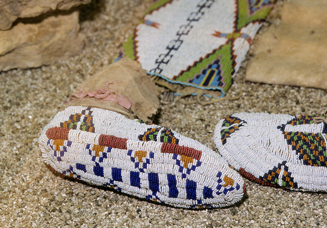 Ute geometric beadwork decorating a pair of ceremonial moccasins on both top and bottom soles