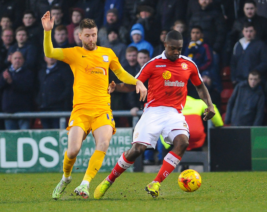 Crewe Alexandra's Greg Leigh holds off the challenge from Preston North End's Paul Gallagher<br /> <br /> Photographer Craig Thomas/CameraSport<br /> <br /> Football - The Football League Sky Bet League One - Crewe Alexandra v Preston North End - Sunday 28th December 2014 - Alexandra Stadium - Crewe<br /> <br /> &copy; CameraSport - 43 Linden Ave. Countesthorpe. Leicester. England. LE8 5PG - Tel: +44 (0) 116 277 4147 - admin@camerasport.com - www.camerasport.com