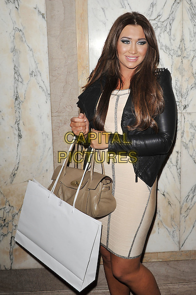 Lauren Goodger.Arrivals at the Luxury and Lifestyle Awards, Porchester Hall, London, England..March 17th 2012.half 3/4 length black dress cream beige leather bag purse beige shopping .CAP/MAR.© Martin Harris/Capital Pictures.