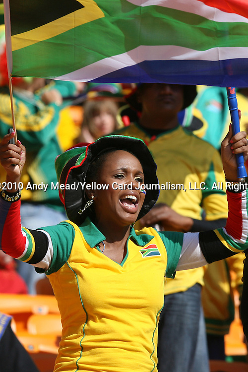 11 JUN 2010: South African fan in the stands of the Soccer City Stadium waving a flag, pregame. The South Africa National Team played the Mexico National Team at Soccer City Stadium in Johannesburg, South Africa in the opening match of the 2010 FIFA World Cup.