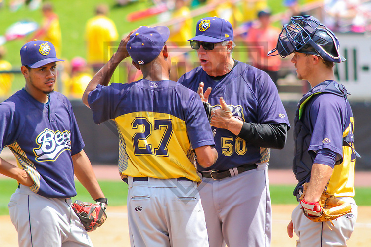 Burlington Bees shortstop Juan Moreno (2), pitcher Adrian Almeida (27), pitching coach Jairo Cuevas (50) and catcher Jack Kruger (39) during a Midwest League game against the Wisconsin Timber Rattlers on July 10, 2017 at Fox Cities Stadium in Appleton, Wisconsin.  Burlington defeated Wisconsin 6-3. (Brad Krause/Krause Sports Photography)