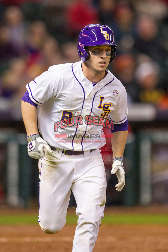 LSU Tigers shortstop Alex Bregman (8) runs to first base during the NCAA baseball game against the Houston Cougars on March 6, 2015 at Minute Maid Park in Houston, Texas. LSU defeated Houston 4-2. (Andrew Woolley/Four Seam Images)