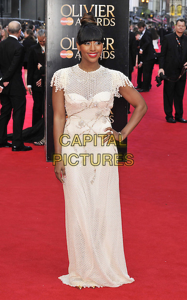 LONDON, ENGLAND - APRIL 13: Alexandra Burke attends the Olivier Awards 2014, Royal Opera House, Covent Garden, on Sunday April 13, 2014 in London, England, UK.<br /> CAP/CAN<br /> &copy;Can Nguyen/Capital Pictures