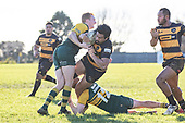 Taine McQoid and Josh Baverstock tackle Pat Masoe short of the tryline. Counties Manukau Premier Club Rugby game between Bombay and Pukekohe, played at Bombay on Saturday June 30th 2018.<br /> Bombay won the game 24 - 14 after leading 24 - 0 at halftime.<br /> Bombay 24 - Sepuloni Taufa, Tulele Masoe, Chay Mackwood, Liam Daniela tries, Ki Anufe 2 conversions.<br /> Pukekohe Mitre 10 Mega 14 - Joshua Baverstock, Gregor Christie tries; Cody White 2 conversions.<br /> Photo by Richard Spranger.