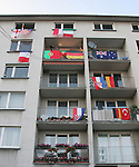 16 June 2006: A residential building facing FIFA Fan Fest is covered with the flags of many different countries in Frankfurt, site of several games during the FIFA 2006 World Cup.