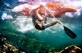 USA, California, Forks of Salmon, kayaker shot from underwater, Salmon River, Otter Bar Kayaking School