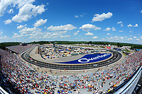 July 16, 2017 - Loudon, New Hampshire, U.S. -  Cars speed by the Overton's logo painted between turns 1 and 2 during the NASCAR Monster Energy Overton's 301 race held at the New Hampshire Motor Speedway in Loudon, New Hampshire. Larson placed first in the qualifier. Eric Canha/CSM