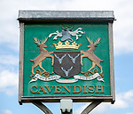 Village sign coat of arms heraldry, Cavendish, Suffolk, England, UK