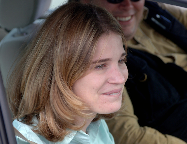 Newsday reporter, Bridget O'Brien, and Photographer Tom Ferrara, in Farmingville on December 31, 2003. Photo by Jim Peppler,
