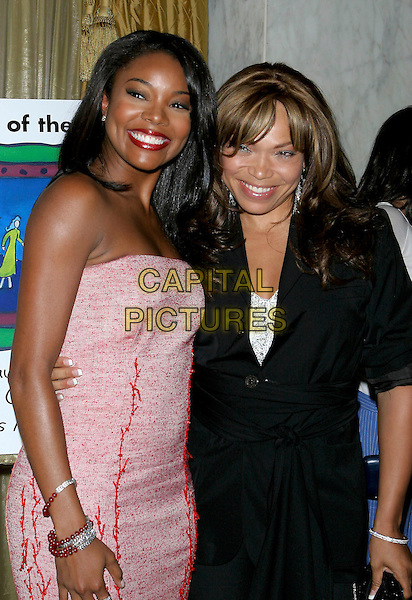 GABRIELLE UNION & TISHA CAMPBELL MARTIN.The 9th Annual Family Matters Benefit and Celebration held Regent Beverly Wilshire Hotel, Beverly Hills, California.June 3rd, 2005.Photo credit: Jacqui Wong/AdMedia.half length pink strapless tweed dress.www.capitalpictures.com.sales@capitalpictures.com.© Capital Pictures.