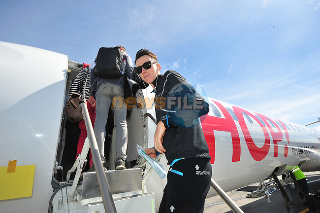 Romain Bardet (FRA) AG2R boards the plane to take the teams to the start of Stage 21 of the 2015 Tour de France running 109.5km from Sevres to Paris - Champs Elysees, France. 26th July 2015.<br /> Photo: ASO/B.Bade/Newsfile