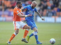 Blackpool's Liam Feeney vies for possession with Peterborough United's Lewis Freestone<br /> <br /> Photographer Kevin Barnes/CameraSport<br /> <br /> The EFL Sky Bet League One - Blackpool v Peterborough United - Saturday 13th April 2019 - Bloomfield Road - Blackpool<br /> <br /> World Copyright &copy; 2019 CameraSport. All rights reserved. 43 Linden Ave. Countesthorpe. Leicester. England. LE8 5PG - Tel: +44 (0) 116 277 4147 - admin@camerasport.com - www.camerasport.com