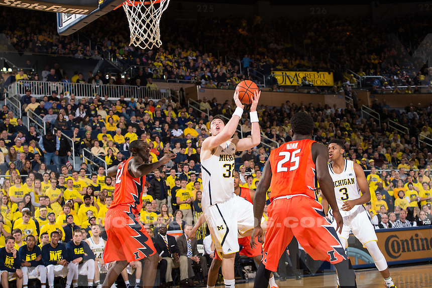 The University of Michigan basketball team defeats Illinois, 73-65, in overtime at Crisler Center in Ann Arbor, on Dec. 30, 2014.