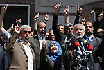 The widow (C) of the Islamist movement Hamas' killed military commander Mazen Faqha speaks alongside the group leader Ismail Haniyeh (R) at a press conference in Gaza City on May 11, 2017, in which the group announced the arrest of the suspected murderer of one of its key military commanders, Mazen Faqha, who was shot dea don March 24, 2017 near his home in Gaza City. No details were provided on the suspect's identity, though Hamas has previously suggested Palestinian collaborators worked with Israel on the assassination. Photo by Ashraf Amra