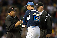 Home plate umpire Ken Eldridge explains a call to UCLA Bruins head coach John Savage #22 during game action versus the Baylor Bears in the 2009 Houston College Classic at Minute Maid Park February 28, 2009 in Houston, TX.  The Bears defeated the Bruins 5-1. (Photo by Brian Westerholt / Four Seam Images)