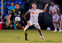 16th July 2020, Orlando, Florida, USA;  New York Red Bulls midfielder Marc Rzatkowski (90) and Columbus Crew midfielder Artur (8) during the MLS Is Back Tournament between the Columbus Crew SC versus New York Red Bulls on July 16, 2020 at the ESPN Wide World of Sports, Orlando FL.