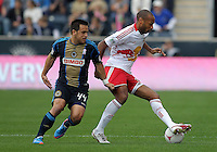 CHESTER, PA - OCTOBER 27, 2012:  Danny Cruz (44) of the Philadelphia Union grabs hold of the shorts of  Thierry Henry (14) of the New York Red Bulls during an MLS match at PPL Park in Chester, PA. on October 27. Red Bulls won 3-0.