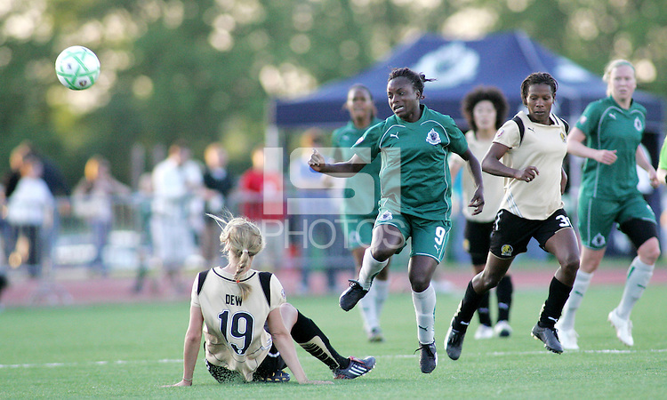 Carrie Drew makes a tackle on Eniola Aluko #9..Saint Louis Athletica defeated FC Gold Pride 1-0 at Ralph Korte Stadium, Edwardsville, Illinois.