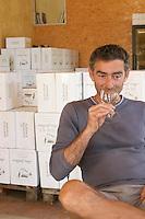 Olivier Jullien Domaine Mas Jullien, Jonquieres village. Terrasses de Larzac. Languedoc. Owner winemaker. Tasting wine. France. Europe.