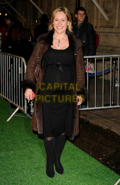 "SOPHIE RAWORTH.Attending the Cirque Du Soleil ""Varekai"" Premiere at the Royal Albert Hall, London, England,.January 8th 2007. full length brown coat fur collar black dress boots pregnant .CAP/CAN.©Can Nguyen/Capital Pictures"