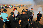 Palestinian protesters gather during clashes with Israeli troops in tents protest where Palestinians demand the right to return to their homeland at the Israel-Gaza border, in east of Gaza city on September 7, 2018. Photo by Dawoud Abo Alkas