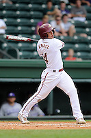 Shortstop Antonio Alvarez (14) of the Elon Phoenix bats in a game against the Furman Paladins in a first-round Southern Conference playoffs game on Wednesday, May 22, 2013, at Fluor Field at the West End in Greenville, South Carolina. Furman won, 10-1. (Tom Priddy/Four Seam Images)