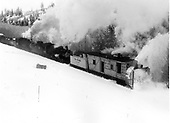 1974 Winter Special with K-36 #483 and #487 pushing Rotary OM throwing snow.<br /> C&amp;TS  Cumbres - Coxo area, CO  1974