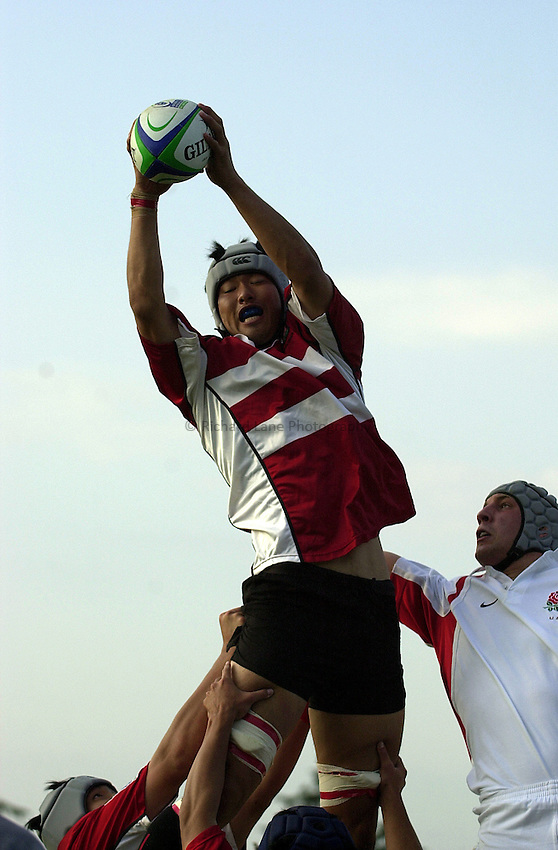 Photo: Richard Lane..Japan U21 v England U21. IRB Under U21 Rugby World Cup 2003 at Newbury RFC. 17/06/2003..Koji Shinozuka wins a lineout.