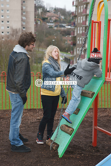 White family at playground.