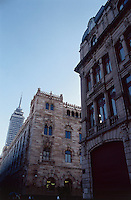 The Correos building stands in stark contrast to a more modern Torre Latinoamericano in the background. Mexico City
