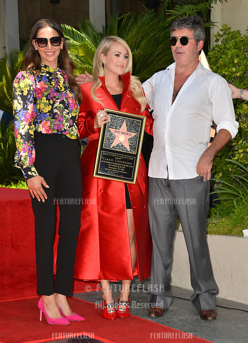 LOS ANGELES, CA. September 20, 2018: Carrie Underwood, Simon Cowell &amp; Lauren Silverman at the Hollywood Walk of Fame Star Ceremony honoring singer Carrie Underwood.<br /> Pictures: Paul Smith/Featureflash