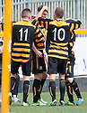 Alloa's Stephen Simmons (centre) celebrates after he scores their first goal.