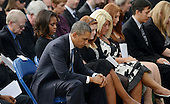 United States President Barack Obama, first lady Michelle Obama, and families of the victims reflect at a memorial for the victims of the Washington Navy Yard shooting at the Marine Barracks, September 22, 2013 in Washington, D.C.  The President and first lady also visited with families of the victims. <br /> Credit: Olivier Douliery / Pool via CNP