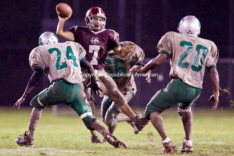 NAUGATUCK--12 September 2008--091208TJ05 - Wilby defenders pressure Naugatuck quarterback Erich Broadrick (7) during Naugatuck High School's 14-0 win against Wilby High School on Friday, September 12, 2008. (T.J. Kirkpatrick/Republican-American)