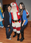 Victoria Justice and her mom with Santa visits the children at CHOC during the KIIS FM Live Broadcast at Children's Hospital Orange County  in Orange, California on December 19,2011                                                                               © 2011 DVS / Hollywood Press Agency