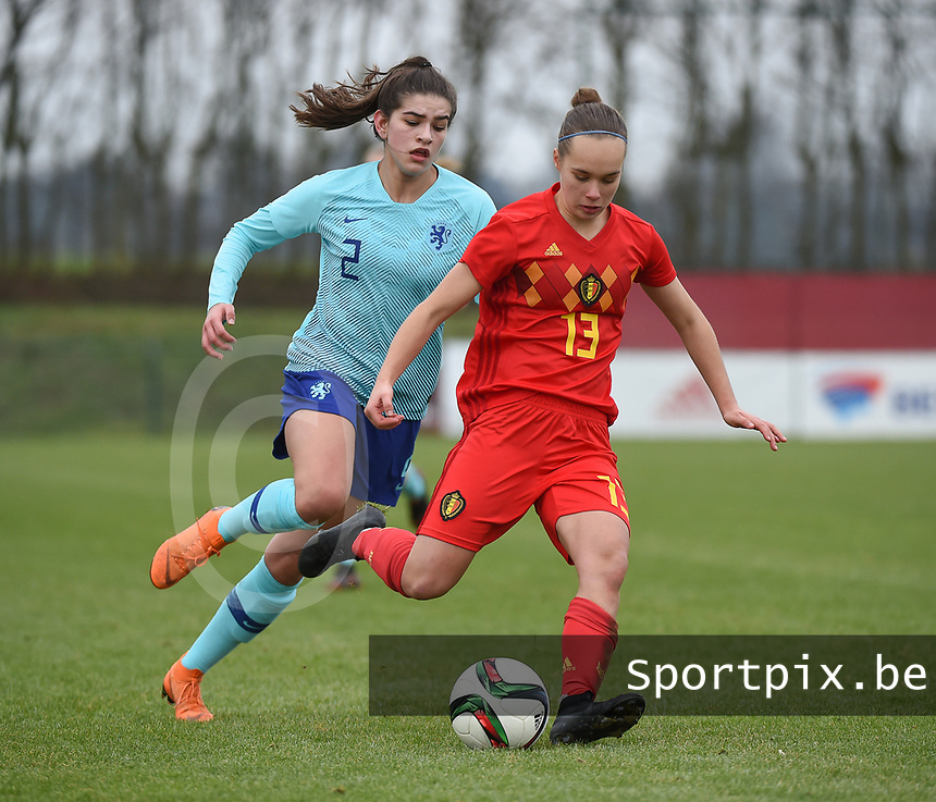 20190206 - TUBIZE , BELGIUM : Belgian Marith De Bondt (13) and Dutch Zaina Bouzerrade (2) pictured during the friendly female soccer match between Women under 17 teams of  Belgium and The Netherlands , in Tubize , Belgium . Wednesday 6th February 2019 . PHOTO SPORTPIX.BE DIRK VUYLSTEKE