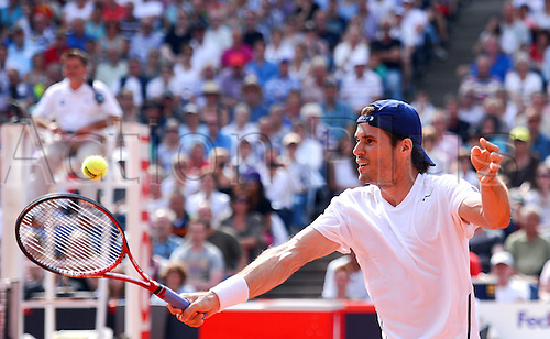 17.07.2013. Hamburg, Germany.  Tommy Haas of Germany returns the ball in the second round match against Slovenia's Kavcic during the ATP tournament in Hamburg, Germany, 17 July 2013.