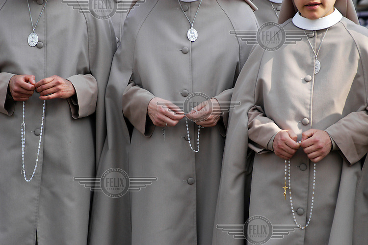 Catholic nuns with rosary beads, amongst a crowd gathered in St. Peter's Square in the Vatican City to pray for Pope John Paul II, who died that evening.