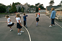 Schoolchildren playing netball during their sports lesson in school playing fields. They are being instructed by a PE teacher. This image may only be used to portray the subject in a positive manner..©shoutpictures.com..john@shoutpictures.com