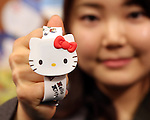 February 8, 2017, Tokyo, Japan - Japan's character giant Sanrio employee displays Sanrio's character Hello Kitty designed wrist watch at the company's latest products exhibition at Sanrio headquarters in Tokyo on Wednesday, February 8, 2017. The watch displays time with LED and priced 1,500 yen (14 US dollars).    (Photo by Yoshio Tsunoda/AFLO) LwX -ytd-